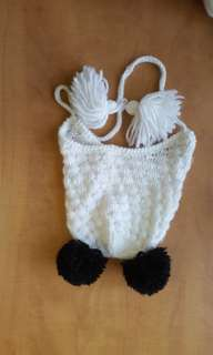 White Hat with Black Pom Poms