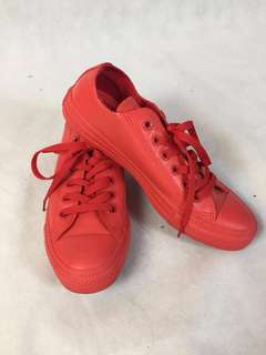 Red rubber converse shoes