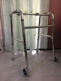 Adult walker with wheels