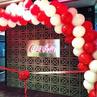 Opening ceremony balloon arch and red ribbon