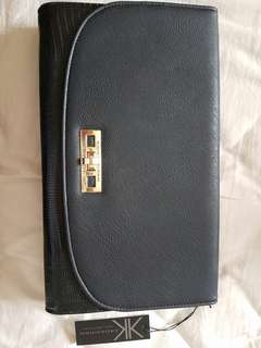 Sleek & sexy Kardashian Kollection black clutch