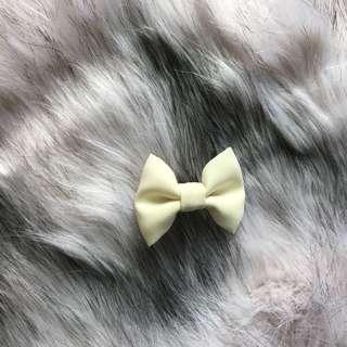 Tiny cream bow
