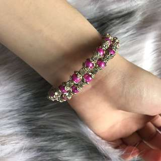 Silver bangle with pink pearls and diamond studs