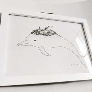 Dolphin drawing in frame
