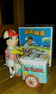 Vintage windup ice cream vendor.