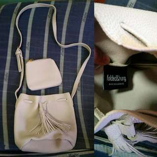 folded & hung Sling Bag w/ coin purse