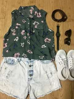 Sleeveless floral green top