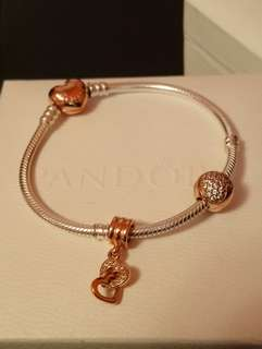 Pandora Rose gold and silver bracelet with rose gold charms