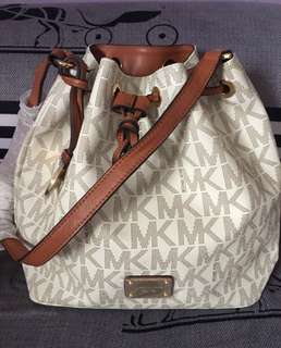 Michael Kors Bucket made in Indonesia with slightly flaw the string strap show in the pictures