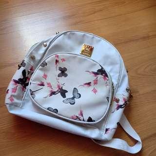 Mini backack or small white bag