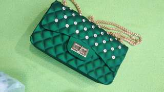 handbag raya. emerald green