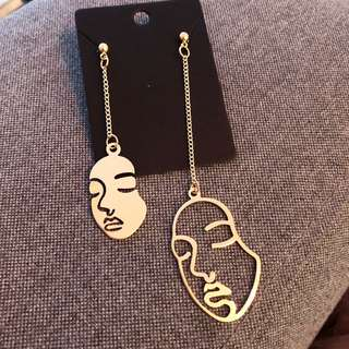 Abstract face dangling earrings