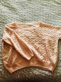 Pink hollowed-out oversized knit jumper