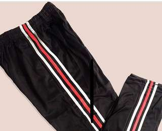 black track pants red/white