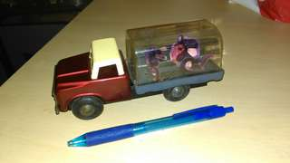 Rare Vintage China made animal transport tin toy truck.