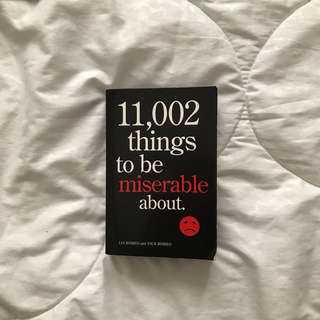 11,002 Things To Be Miserable About by Lia and Nick Romeo