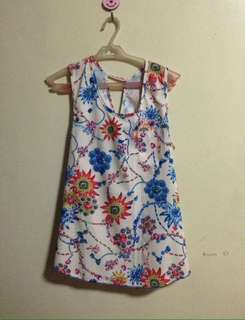 Floral top with slight open back