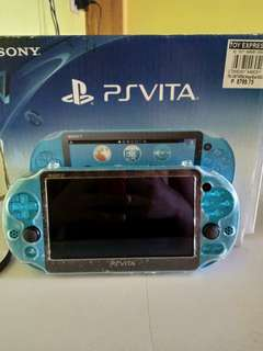 Ps vita blue with box and games