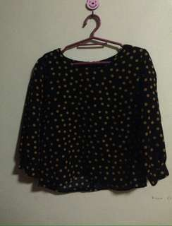 Black long sleeves with orange polka dots