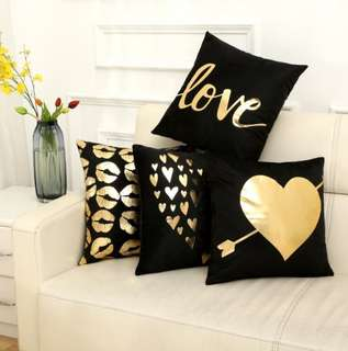 Black cushion covers in bronze lining