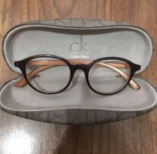 Calvin Klein Round Brown Specs
