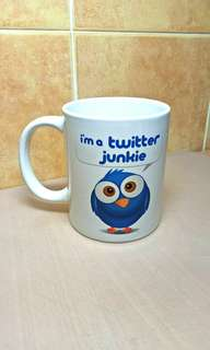 Twitter Junkie Coffee Mug with a box.