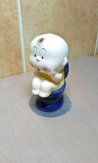 Baby sitting on Toilet Bow ( Vintage figurine )