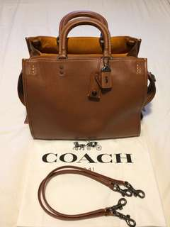 Coach Rogue in traditional Coach colour. This bag will accommodate a laptop. Coach Rogue Laptop Bag retails at 1,375 approx.