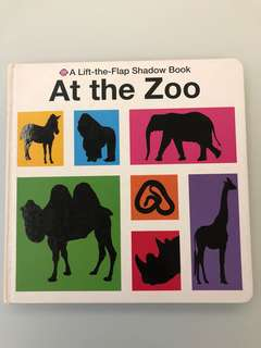 At The Zoo (A Lift-the-Flap Shadow Book