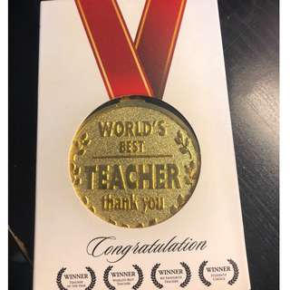 World best teacher award medal