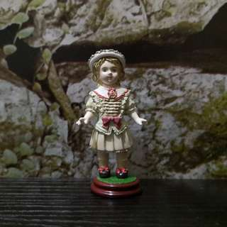Miniature girl figurine