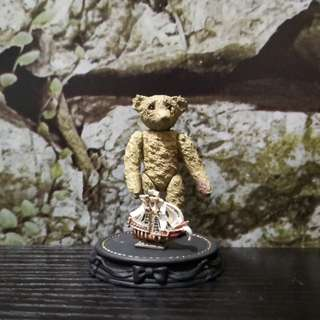 Miniature Teddy bear figurine