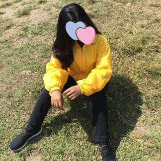 Mustard yellow windbreaker jacket