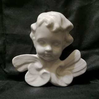 Porcelain angel figurine