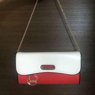 Christian Loubotin clutch bag