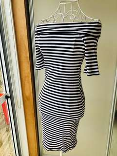 off the shoulder black/white stripe dress . Size M. Stretch fit