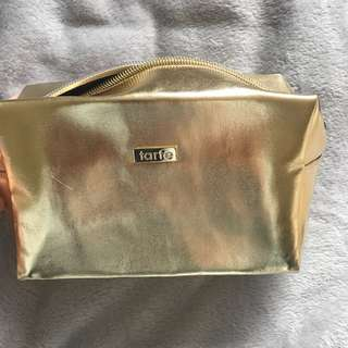 Tarte makeup bag in gold