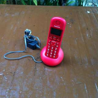 Panasonic cordless telephone with charger. In good working condition.