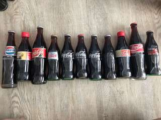 Very rare vintage Coca Cola bottles complete with coke