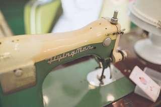 Vintage Flying Man Sewing Machine