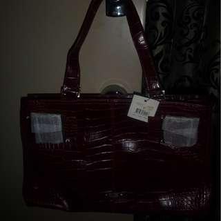 Red snake skin handbag