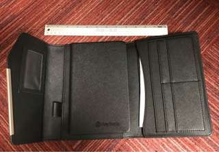 Magnetic faux leather portfolio folder with slots for cards and documents and a matching unlined notebook