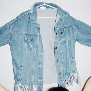 Ripped fringe denim outerwear