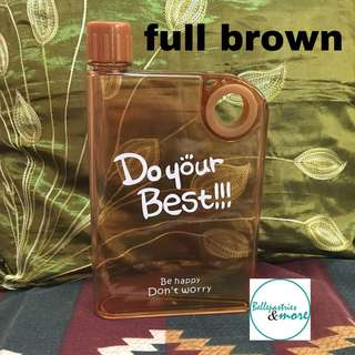 brown notebook portable cup