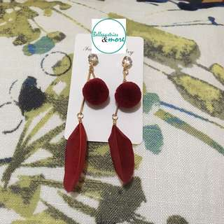 red feather dangling earings