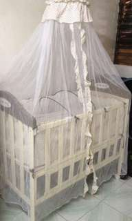 Metal crib with bassinet and princess net