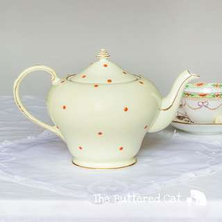 Delightful vintage pale lemon yellow English bone china teapot, hand-decorated, raised polka dots