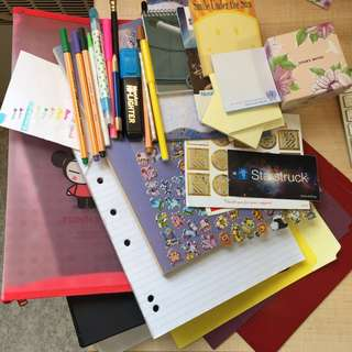 Folders, paper and pens