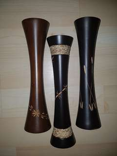 A set of three wooden vases