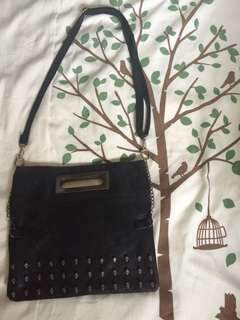 VOICE OF VOICES LEATHER SLING BAG